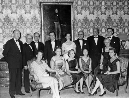 George Currie, second from left, and partners gather at a firm dinner in 1958