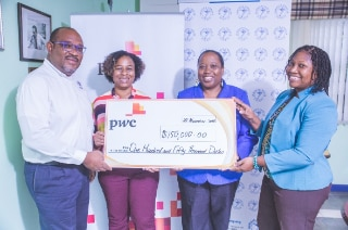 PwC donation to the Jamaica Cancer Society to cover the cost of over 35 mammograms