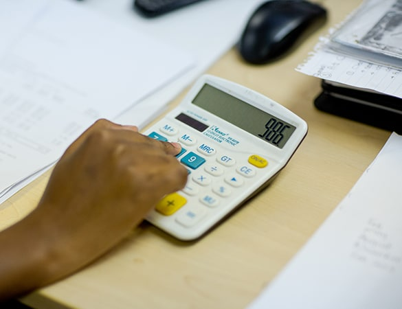 Hand working on a calculator