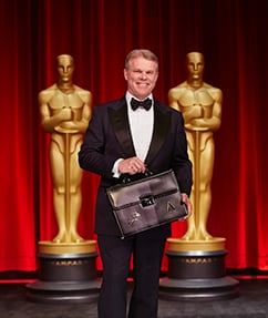 Portrait of Brian Cullinan with Oscars background